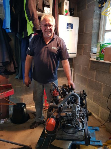 Picture of Brian Brown with the Engine out of the car